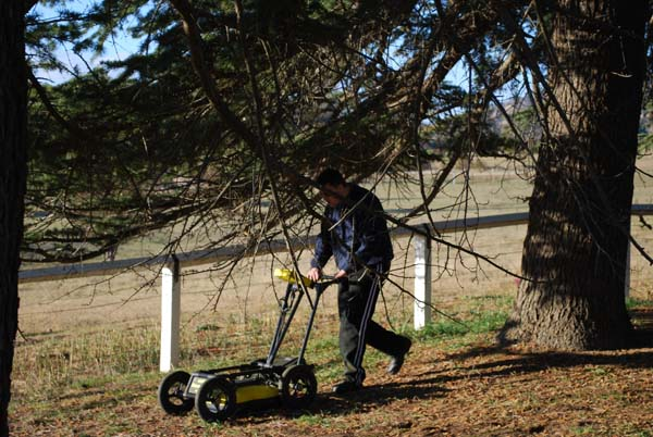 Hunter Geophysics undertaking a GPR survey in a cemetery in Canberra.